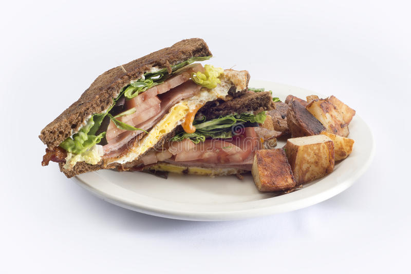 ham egg tomato breakfast sandwich hash browns stock images
