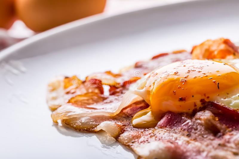 Ham and Eggs. Bacon and Eggs. Salted egg and sprinkled with red pepper. English breakfast.  stock photos
