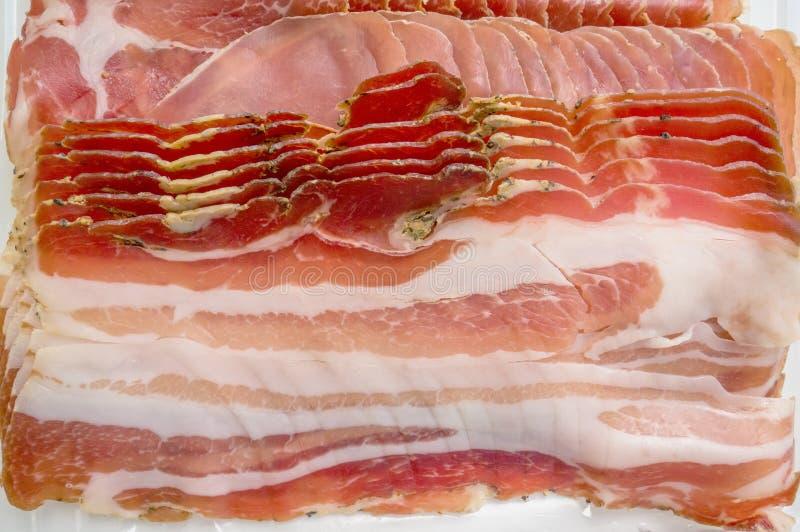 Ham en het gesneden aroma van kruiden, dun Achtergrond royalty-vrije stock afbeeldingen