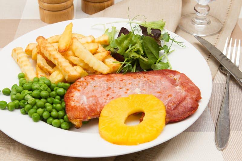Ham-lapje vlees met een ananasring stock fotografie