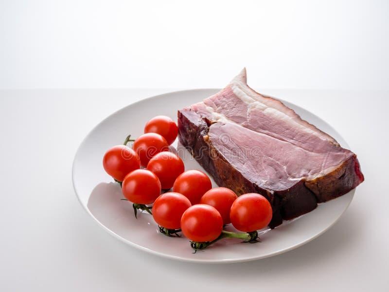 Ham met kleine tomaten royalty-vrije stock foto's