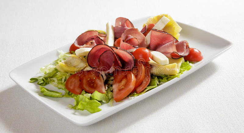 Ham mixed salad. With variety of cheese and carciofo stock photo