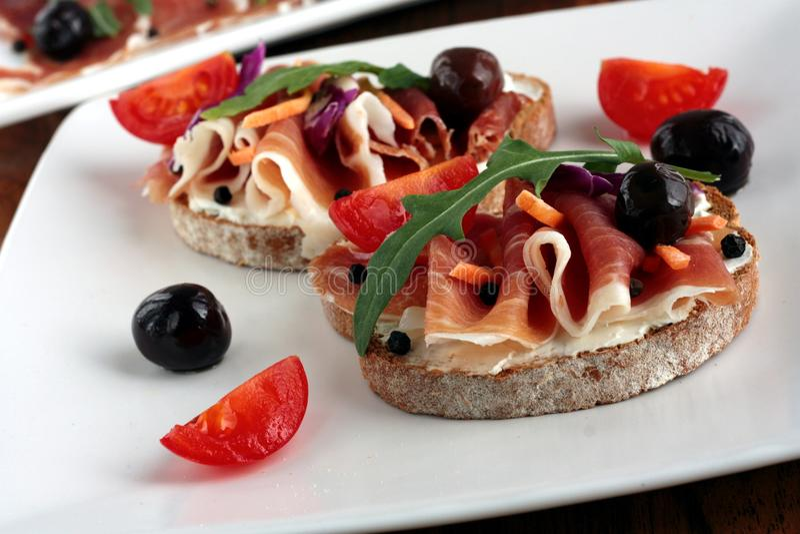 Ham, olives & tomato appetizer stock photos
