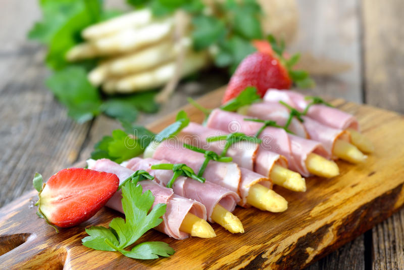 Ham rolls with asparagus stock image