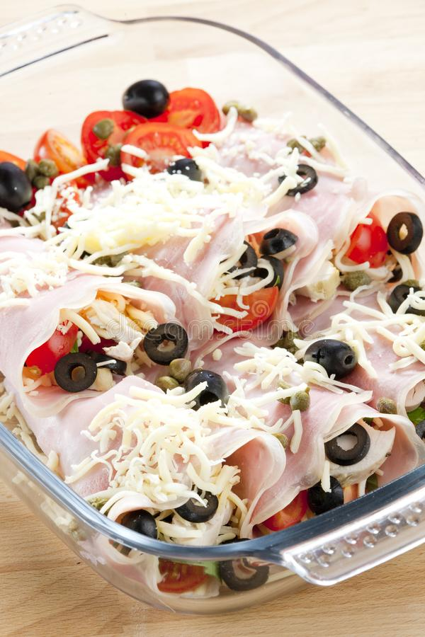 Ham rolls filled with chicken meat and black olives. Inside, indoor, indoors, interior, interiors, gastronomy, cuisine, foodstuff, meal, meals, nutrition stock image