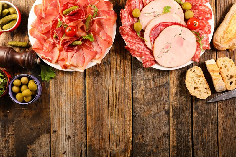 Ham, salami, sausage with baguette royalty free stock photo