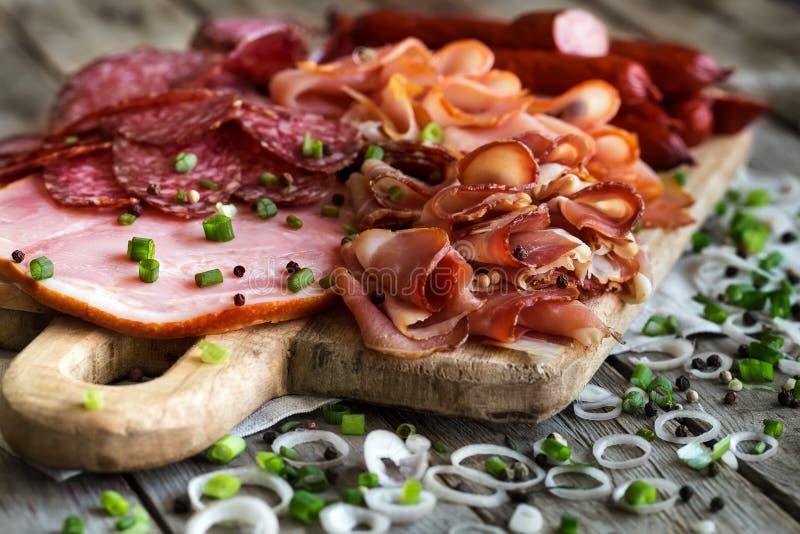 Ham, salami and sausages mix stock photo