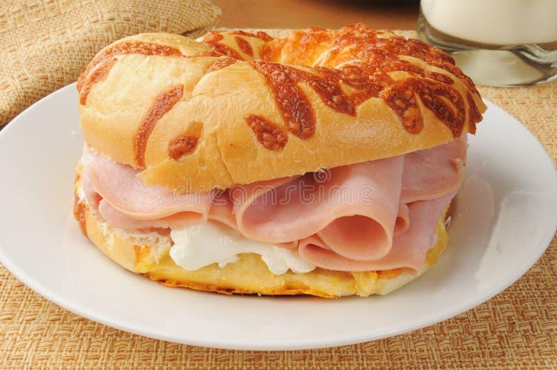 Ham sandwich on an onion bagel royalty free stock photos
