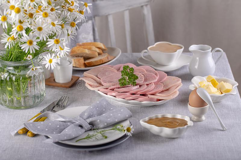 Ham and sausage sliced for breakfast on the table. Ham  sliced stock photography