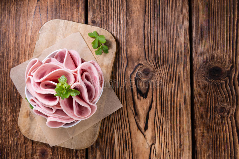 Ham Sausage on wooden background stock photos