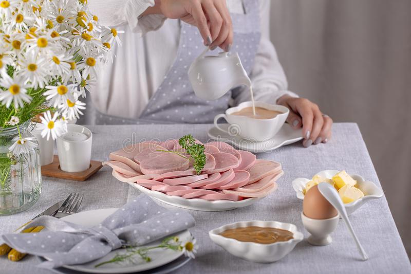 Ham and sausage sliced for breakfast on the table. Ham  sliced for breakfast on the table stock photos