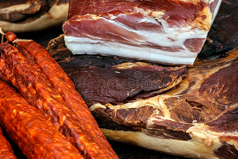 Ham and smoked pork sausage and dried. Pieces of smoked pork bacon overlapping, together with sausages.Traditional Romanian food, shall specify in the month of royalty free stock image