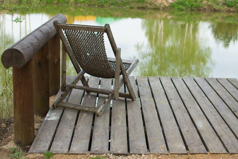 Download Hamaka krzesło zdjęcie stock. Obraz złożonej z rzeka - 53779240