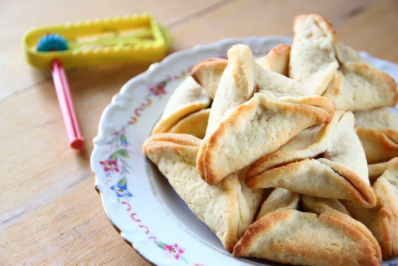 Hamantaschen曲奇饼或hamans耳朵普珥节庆祝的(犹太假日) 免版税库存图片