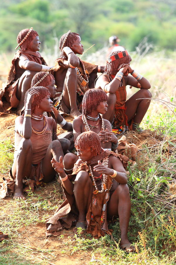 Hamar tribe. A couple of women from the Hamar tribe in Ethiopia sitting together to watch a traditional game royalty free stock photography