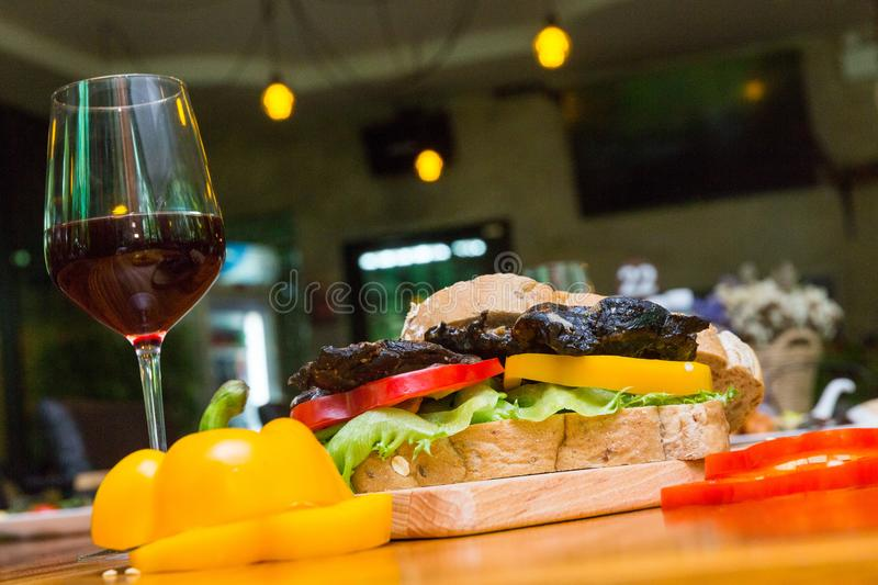 Hamberger chicken on table. Hamberger chicken and wine on wood dish stock photography