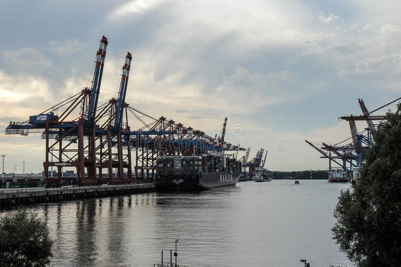 Wide Shot of a large Container Ship and big Container Cranes Gantry Cranes in the port of Hamburg stock photos