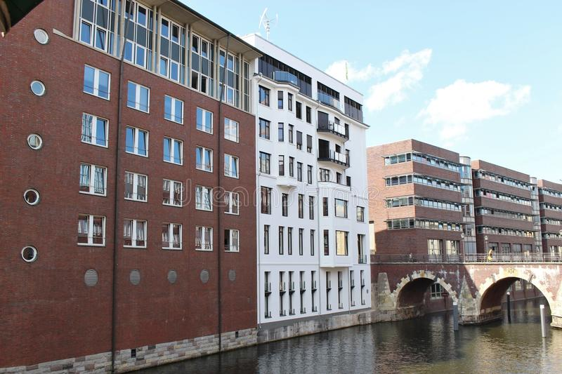 In Hamburg city center, Germany,Europe. A row of brick houses with canal and bridge stock images