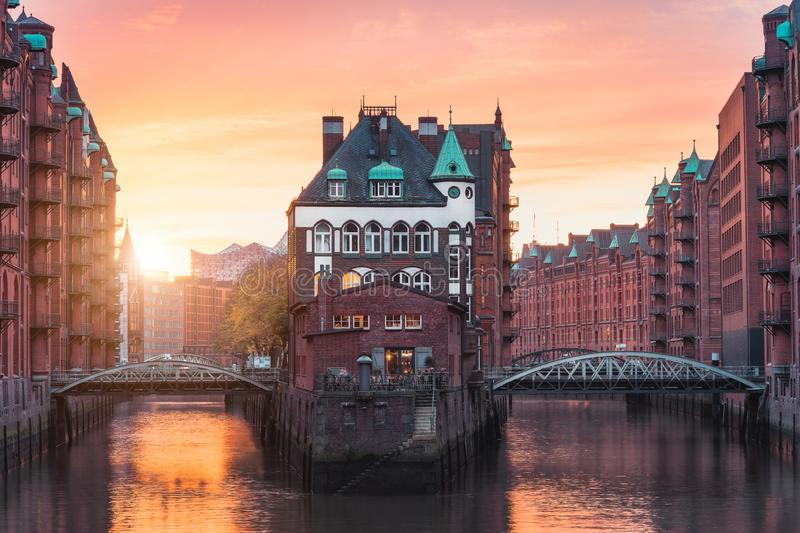 Hamburg city old port, Germany, Europe. Historical famous warehouse district with water castle palace at sunset golden. Light royalty free stock photos