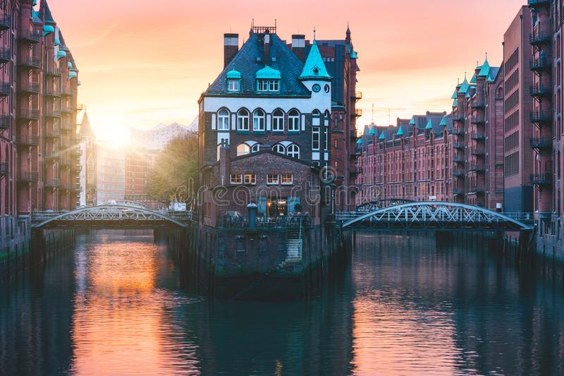 Hamburg city old port, Germany, Europe. Historical famous warehouse district with water castle palace at sunset golden. Light stock images