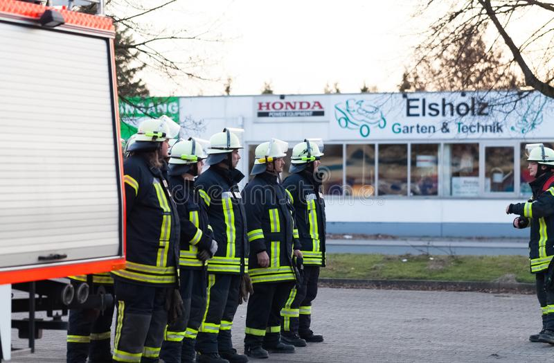 Hamburg, Germany - April 18, 2013: HDR - firefighter team lined up at the briefing.  royalty free stock image