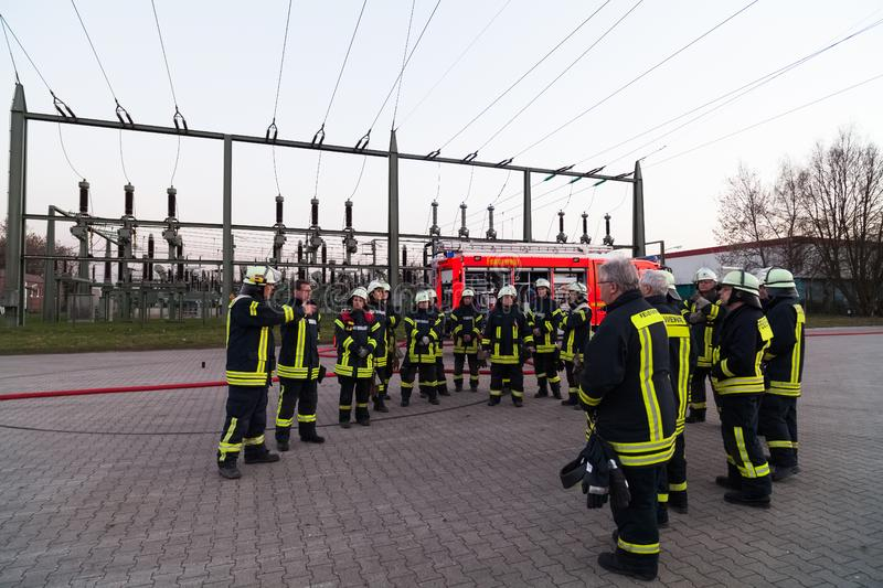 Hamburg, Germany - April 18, 2013: HDR - firefighter team lined up at the briefing.  royalty free stock photography