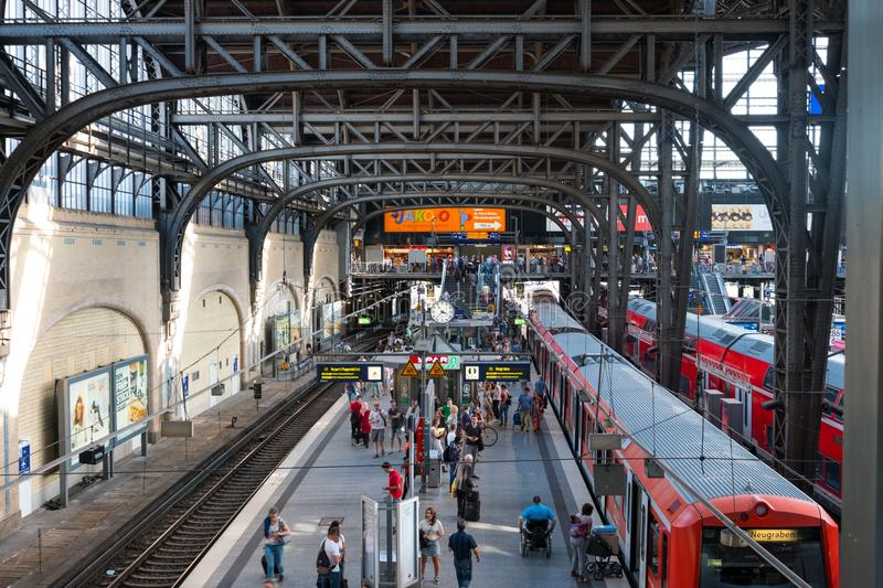 Trains and passengers at main railway station in Hamburg stock images