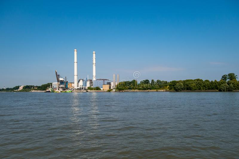 Hamburg, Germany - August 25, 2019 : View at power station Wedel and the banks of Elbe River stock image