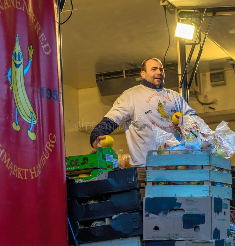 Hamburg, Germany, December 10th 2017: The well-known Banana-Fred sells fruit at the Hamburg Fish Market with loud shouting royalty free stock photos