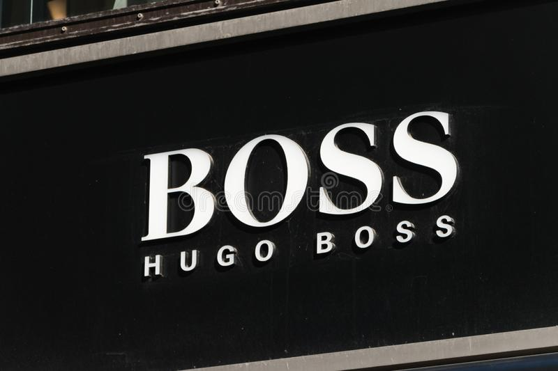 Logo and sign of Hugo Boss. Hugo Boss is German luxury fashion and style house founded in Metzingen at 1924 royalty free stock photography
