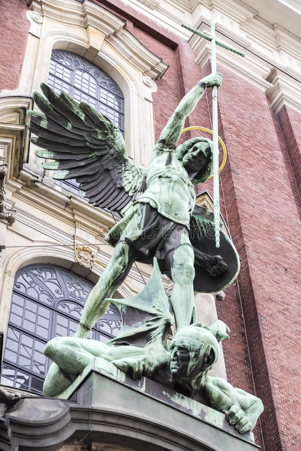 Hamburg, Germany. St. Michael`s Victory over the Devil, sculpture above the main entrance of St. Michael`s Church Hauptkirche Sankt Michaelis royalty free stock photo