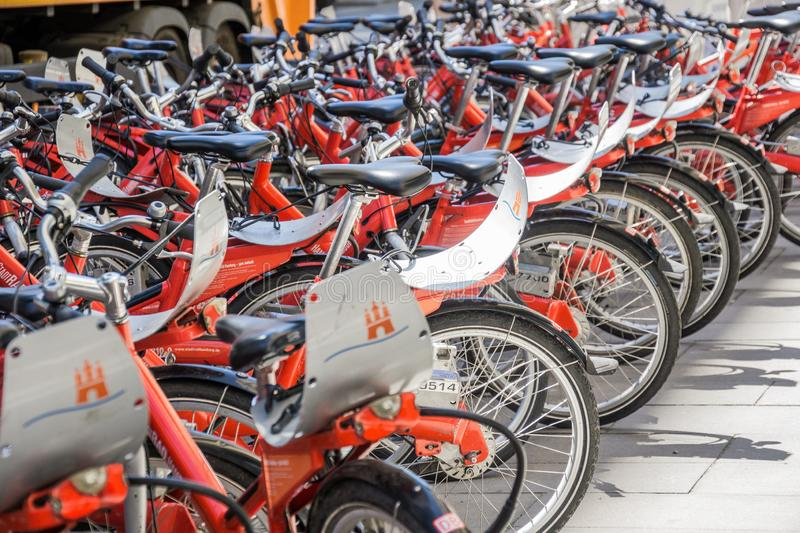 Hamburg, Germany, June 6., 2018: A lot of red rental bikes with red frames and black saddles, deliberately low depth of field. Healthy life royalty free stock photos