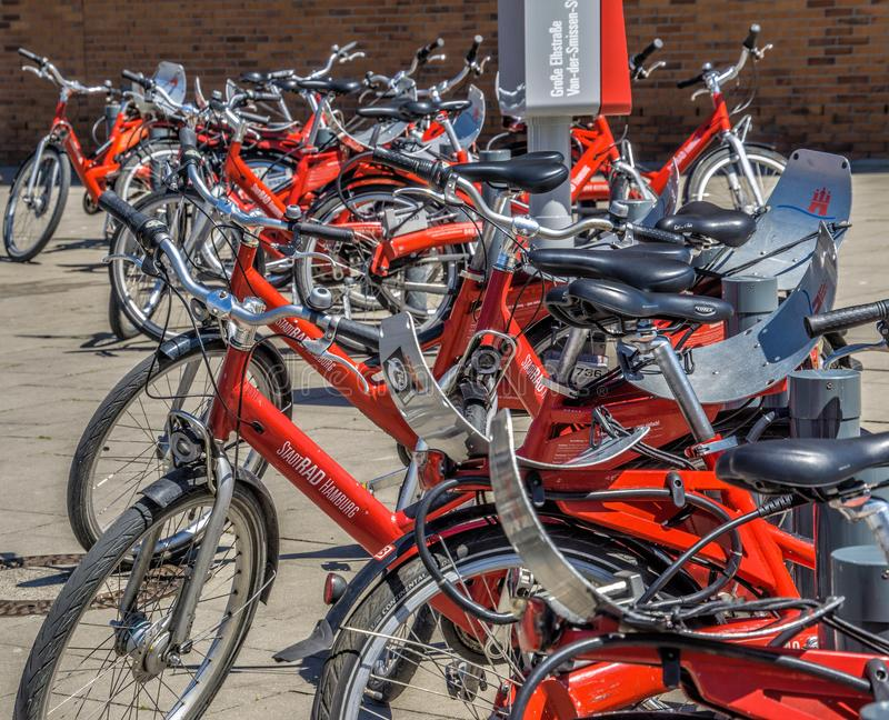 Hamburg, Germany, June 6., 2018: A lot of red rental bikes with red frames and black saddles, deliberately low depth of field royalty free stock image