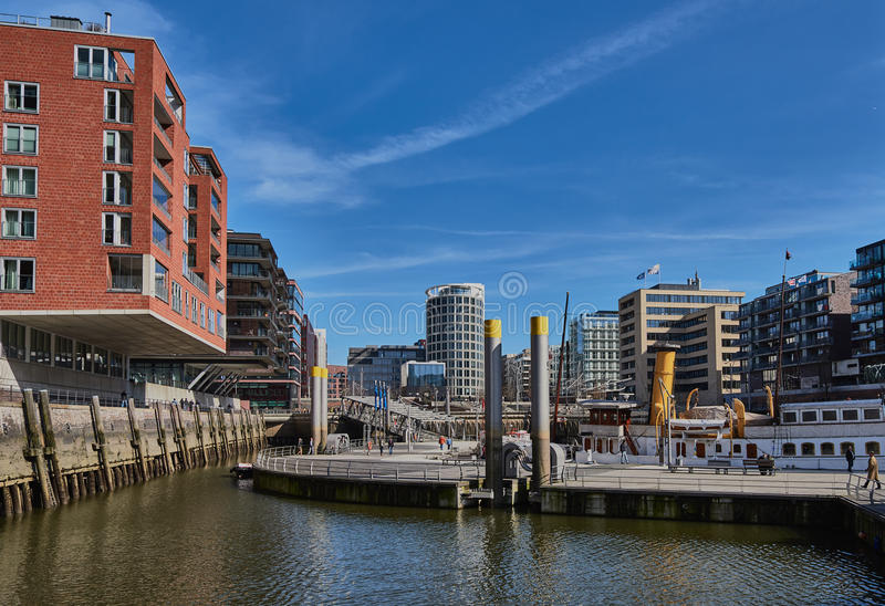 HAMBURG, GERMANY - MARCH 26, 2016: Modern buildings with offices and appartments embrace a little port with historic stock images