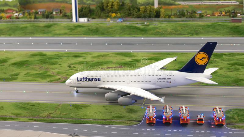 HAMBURG, GERMANY - MARCH 8th, 2014: An Lufthansa Airbus A380 taxiing to runway with fire department in hold at Flughafen. Wunderland. Up to 40 different royalty free stock photos
