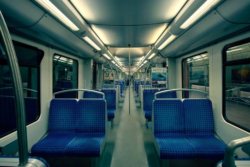 Hamburg, Germany - May 22, 2018: empty seats of modern high speed commuter metro train, night lights turned on stock photo