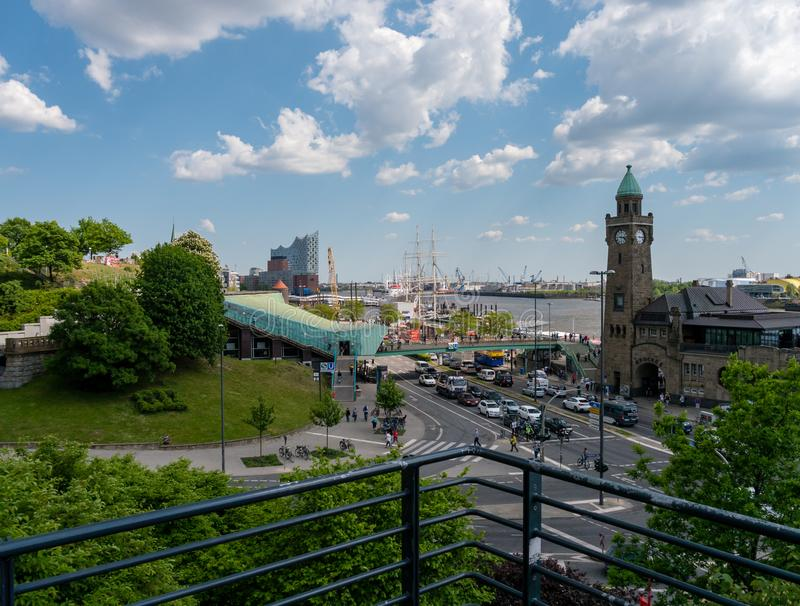 Hamburg, Germany - May 22, 2016: View at Old Elbtunnel, harbour, Landingbridge and Elbphilharmonie at fine weather. Hamburg, Germany - May 22, 2016: View from stock photos