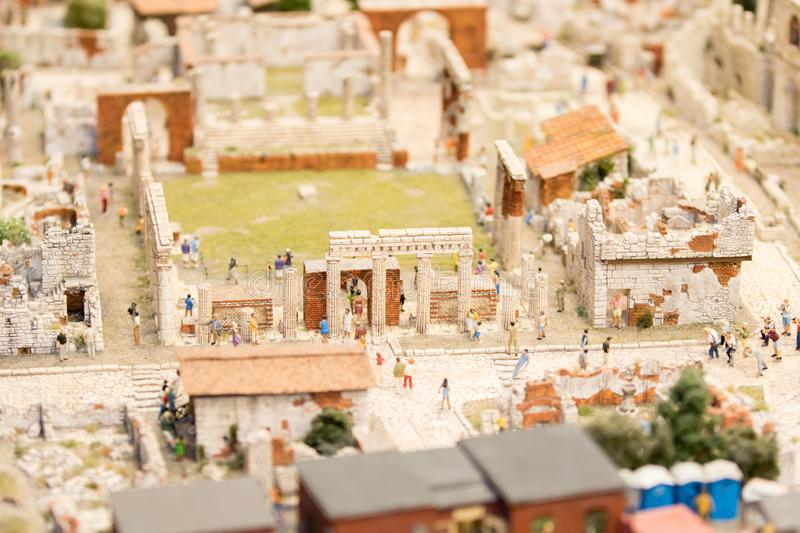 top view of the center of Pompeii in Roman times, with people in the streets of the city royalty free stock photography