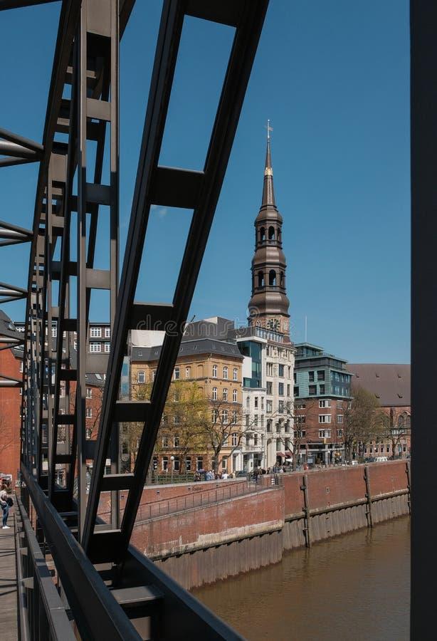 Hamburg, Germany, View of the St. Katharinen Church from the bridge above the canal. Hamburg, Germany - April 18, 2018 - View of the St. Katharinen Church from stock photography