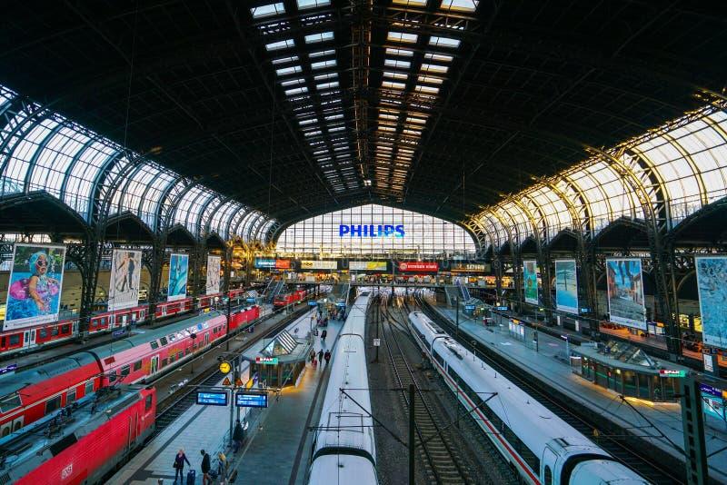 Hamburg Hauptbahnhof railway station. Hamburg Hauptbahnhof wide interior with elevate view of trains, people traveling and huge Philips advertisement. It is one stock images