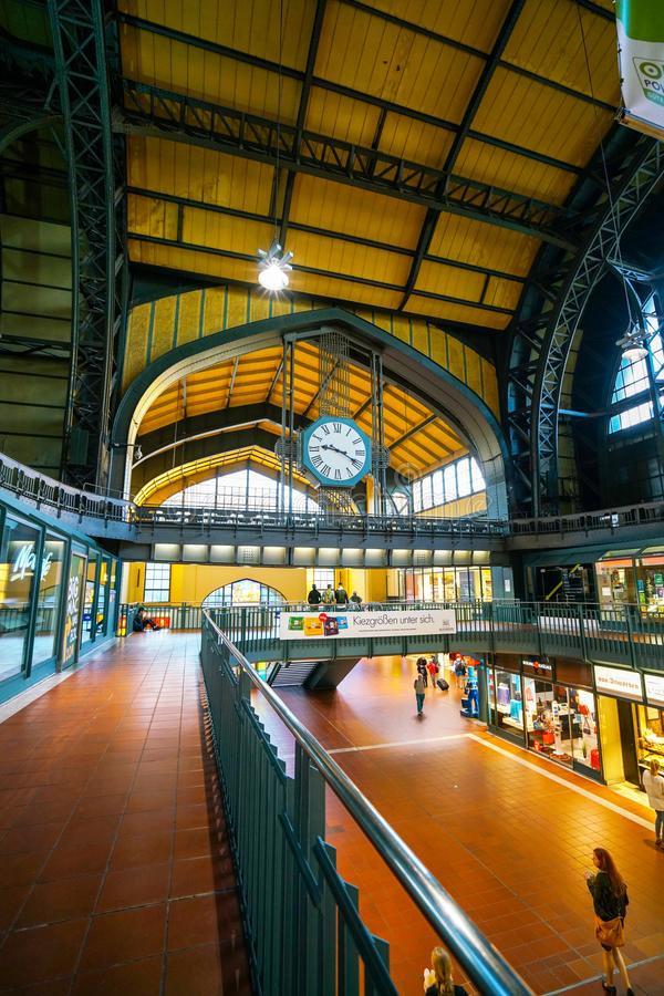 Hamburg Hauptbahnhof railway station. Hamburg Hauptbahnhof wide interior with elevate view of trains, people traveling and huge Philips advertisement. It is one royalty free stock photography