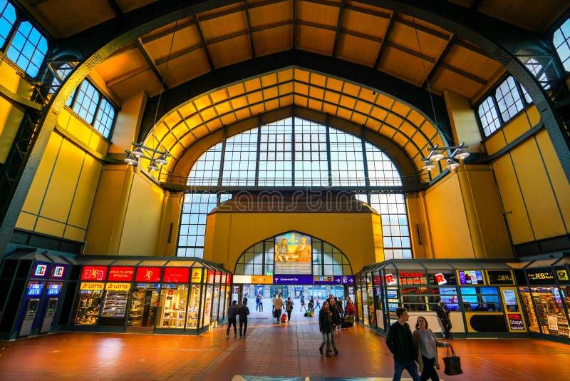 Hamburg Hauptbahnhof railway station. Hamburg Hauptbahnhof wide interior with elevate view of trains, people traveling and huge Philips advertisement. It is one stock image