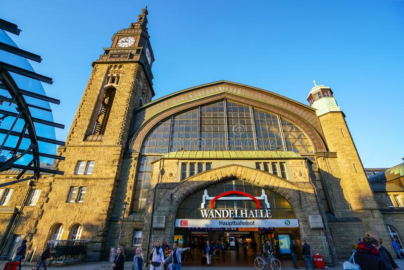 Hamburg Hauptbahnhof railway station. Hamburg Hauptbahnhof wide interior with elevate view of trains, people traveling and huge Philips advertisement. It is one stock photo