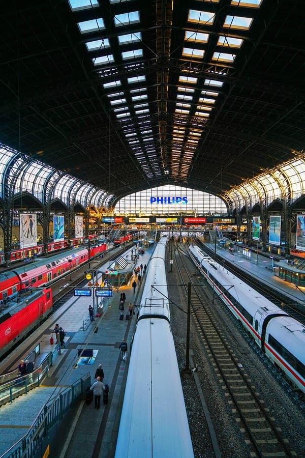 Hamburg Hauptbahnhof railway station. Hamburg Hauptbahnhof wide interior with elevate view of trains, people traveling and huge Philips advertisement. It is one royalty free stock image