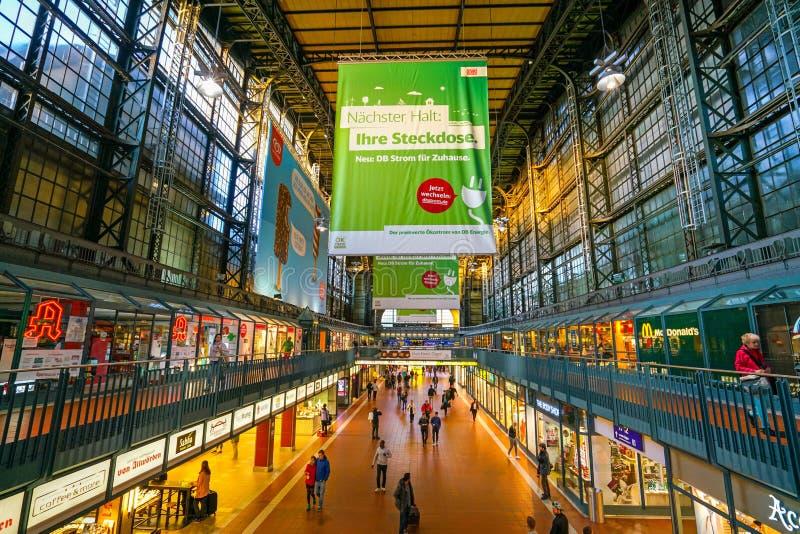 Hamburg Hauptbahnhof railway station. Hamburg Hauptbahnhof wide interior with elevate view of trains, people traveling and huge Philips advertisement. It is one stock photos