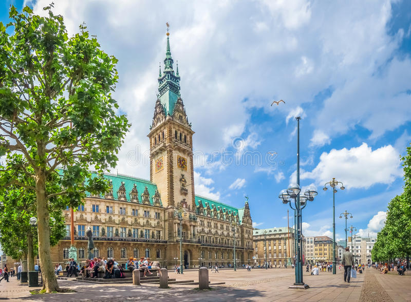 Hamburg town hall at market square in Altstadt quarter, Germany. Beautiful view of famous Hamburg town hall with dramatic clouds and blue sky at market square stock photo