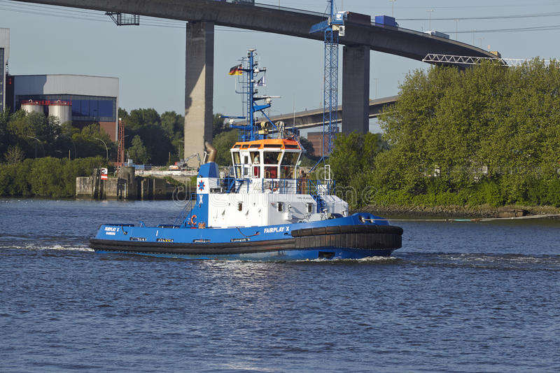 Hamburg - Tugboat under Koehlbrand Bridge. The tugboat Fair Play X under the Koehlbrand Bridge in Hamburg taken on May 2014, 16 stock photos