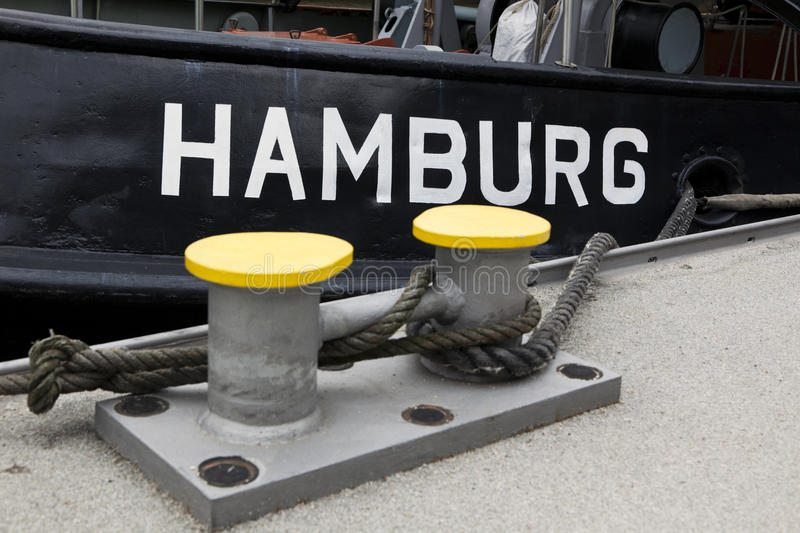 Hamburg written on tugboat. Detail of tugboat at the pier in Hamburg stock photos