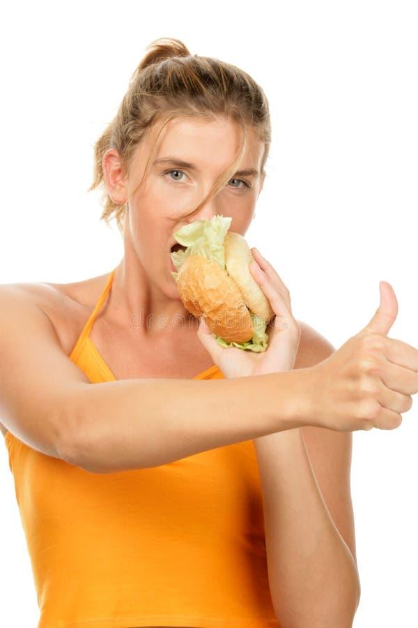 hamburgare som äter kvinnan arkivbilder