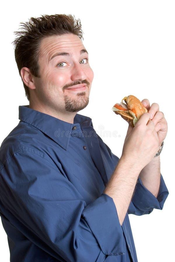 hamburgare som äter mannen arkivbilder